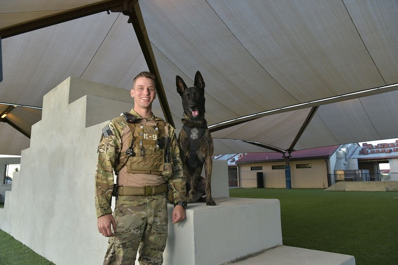 Staff Sgt. Kyle Pethtel, 45th Security Forces Squadron military working dog handler, poses for a photo with Pieter, 45th SFS military working dog, at Patrick Air Force Base, Fla., Nov. 26, 2019. Pethtel and Pieter have been a MWD team since July 2019. (U.S. Air Force photo by Senior Airman Dalton Williams)