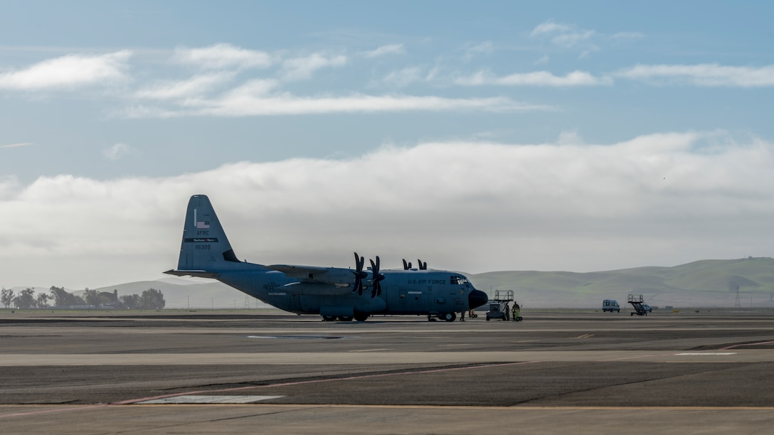 """A WC-130J Super Hercules aircraft from the 53rd Weather Reconnaissance Squadron sits on the flightline prior to an atmospheric river mission Jan. 27 at Travis Air Force Base, Calif. The Hurricane Hunters are slated to perform """"AR recon"""" from January through March. Scientists led by Scripps Institution of Oceanography at University of California, San Diego, in partnership with the 53rd WRS, National Oceanic and Atmospheric Aviation's National Weather Service and Office of Marine and Aviation Operations, will be on standby to fly through these ARs over the Pacific to gather data to improve forecasts. (U.S. Air Force photo by Tech. Sgt. Christopher Carranza)"""