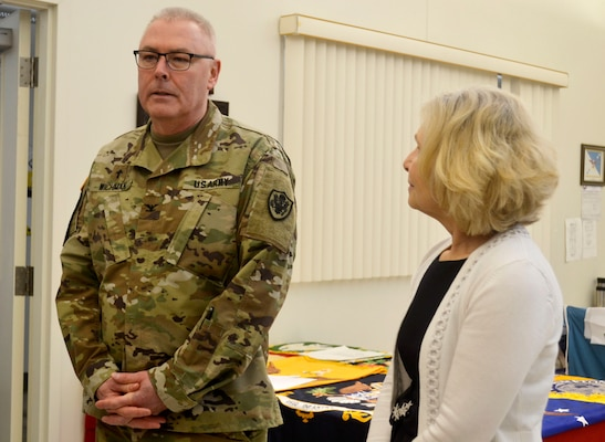 Army Col. Bob Wichman, the DLA Chaplain, left, speaks to DLA Troop Support Flag Room employees during a visit Feb. 5, 2020 at DLA Troop Support in Philadelphia.