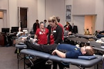 Red Cross personnel help an Employee at the Hart-Dole-Inouye Federal Center donate during the Feb. 5 blood drive.