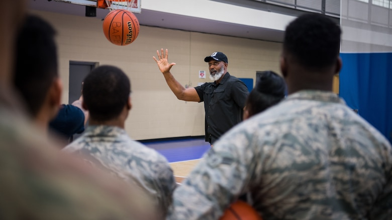 Karl Malone, NBA Hall of Famer, visits with Airmen at the Senior Airman Bell Fitness Center at Barksdale Air Force Base, La., Feb. 4, 2020. Malone spent time talking to Airmen talking about leadership and even giving a few tips to the base intramural basketball team. (U.S. Air Force photo by Airman 1st Class Jacob B. Wrightsman)