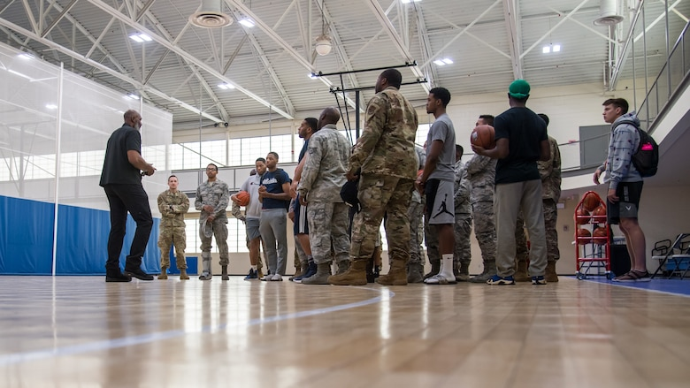 Karl Malone, NBA Hall of Famer, talks with Airmen at the Senior Airman Bell Fitness Center at Barksdale Air Force Base, La., Feb. 4, 2020. Malone spent time talking to Airmen talking about leadership and even giving a few tips to the base intramural basketball team. (U.S. Air Force photo by Airman 1st Class Jacob B. Wrightsman)