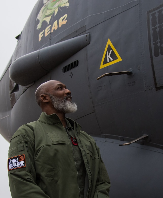 Karl Malone, NBA Hall of Famer, stands next to a B-52H Stratofortress during a visit at Barksdale Air Force Base, La., Feb. 5, 2020. Malone flew a training sortie with the 96th Bomb Squadron during his visit. (U.S. Air Force photo by Airman 1st Class Jacob B. Wrightsman)