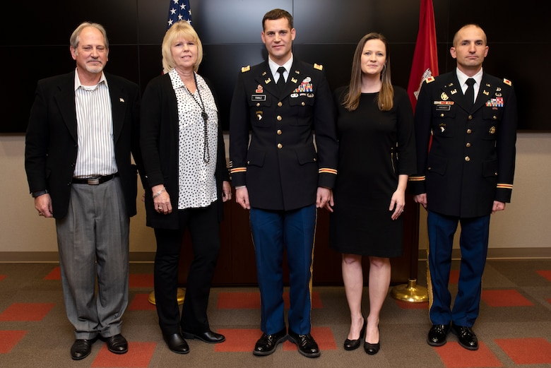 (Left to Right) Rick Toole; Arlene Toole; Maj. Justin Toole, U.S. Army Corps of Engineers Nashville District deputy commander; Katy Toole; and Col. Paul Kremer, Great Lakes and Ohio River Division deputy commander; pose right before promoting the major to the rank of lieutenant colonel during a ceremony at the Nashville District Headquarters in Nashville, Tennessee, Feb. 6, 2020. Rick and Arlene are Justin's parents. Katy is his wife. (USACE Photo by Lee Roberts)
