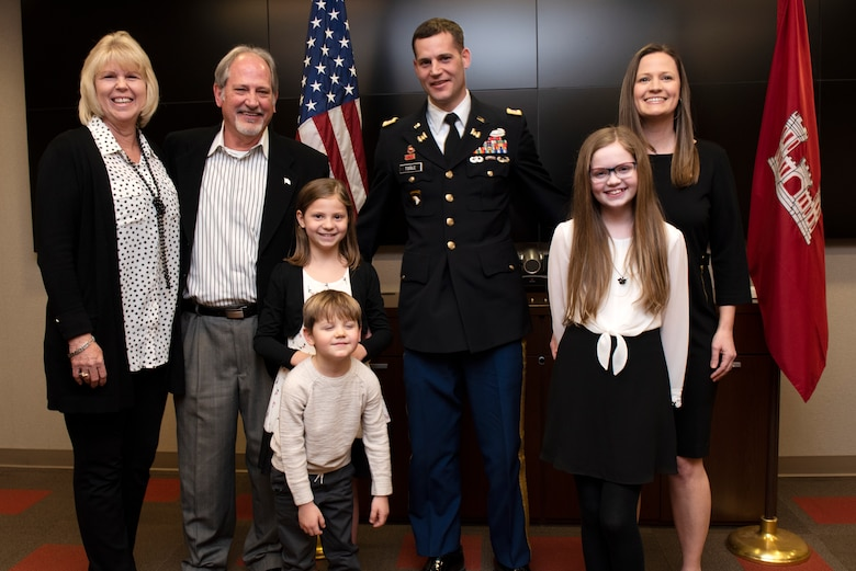 Justin Toole, U.S. Army Corps of Engineers Nashville District deputy commander and newest lieutenant colonel in the Army, poses with his family during his promotion ceremony at the Nashville District Headquarters in Nashville, Tennessee, Feb. 6, 2020. From Left to right are his parents Arlene and Rick, daughter Mya, son Ben, Toole, daughter Caroline, and wife Katy. (USACE photo by Lee Roberts)