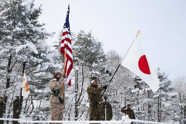 U.S. Marines and Soldiers from Japan Ground Self-Defense Force (JGSDF) watch as flags are presented during an opening ceremony for exercise Northern Viper on Hokudaien Training Area, Hokkaido, Japan, Jan. 26, 2020. Northern Viper is a regularly scheduled training exercise that is designed to enhance the interoperability of the U.S. and Japan Alliance by allowing infantry units to maintain their lethality and proficiency in infantry and combined arms tactics. (U.S. Marine Corps Photo By Cpl. Cameron E. Parks)