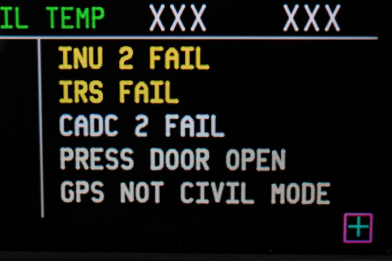 """A simulated """"PRESS DOOR OPEN"""" warning is displayed on the Multifunction Display Unit at the C-5M flight engineer's panel trainer Jan. 28, 2020, at the 373rd Training Squadron, Detachment 3 on Dover Air Force Base, Del. During a recent mission dubbed Reach 190, an aircrew from the 9th Airlift Squadron had a """"PRESS DOOR OPEN"""" warning appeared on the pilot's, copilot's and flight engineer's Multifunction Display Units, caused by a crew door """"NOT LOCKED"""" light indication on the C-5M left-hand forward loadmaster control panel while in flight. (U.S. Air Force photo by Roland Balik)"""