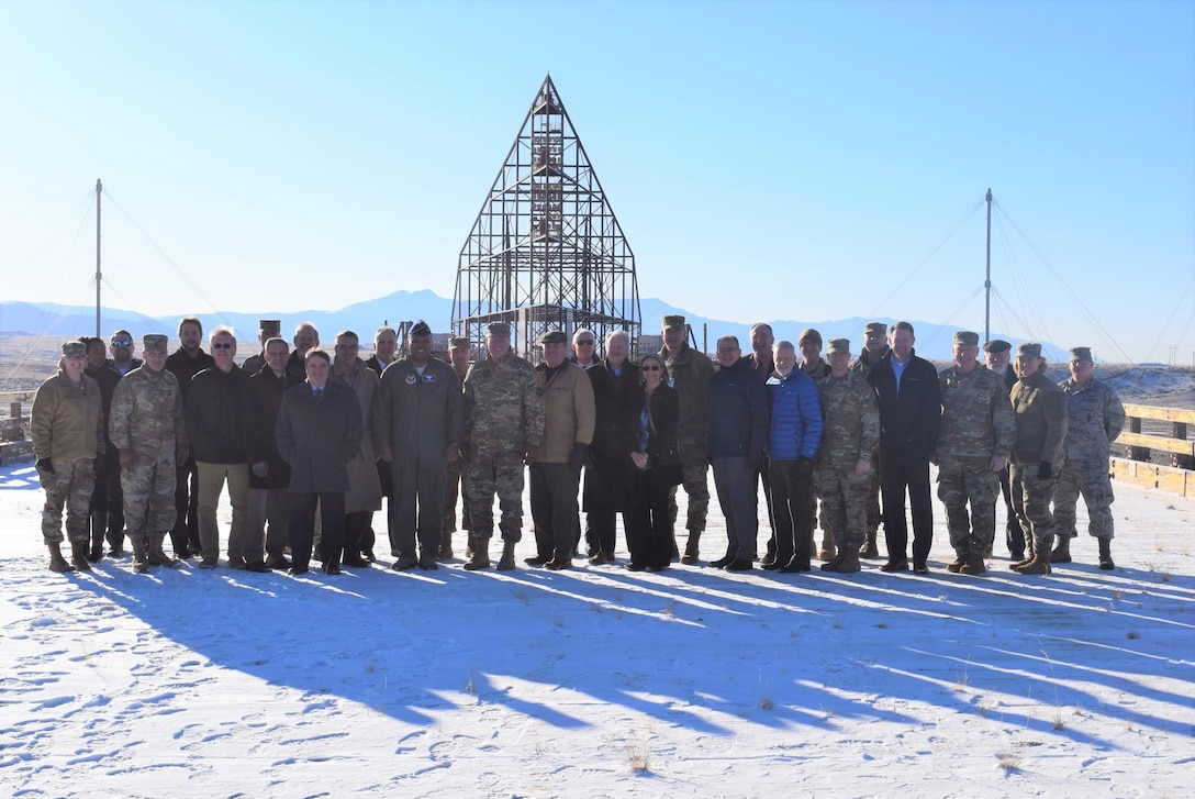 The Air Force Nuclear Issues Resolution and Integration Board held its winter meeting at the center on Feb. 6, 2020, at Kirtland AFB, New Mexico. While there, board members stopped for a photo in front of the Kirtland AFB Trestle Facility. A landmark of the Cold War, it was built in the 1970s to test the effects of an electromagnetic pulse on aircraft and is considered one of the largest all-wood structures in the world, right down to its bolts. (Air Force photo by Capt. Mike Ford).