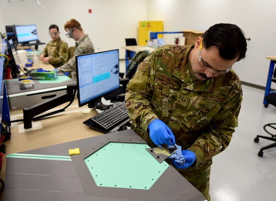 U.S. Air Force Staff Sgt. Gregory Valdez, a 354th Maintenance Squadron F-35A Lightning II Low Observable Aircraft Structural Maintenance Craftsman, conducts a paste repair on an F-35 test panel Jan. 23, 2020, at the field training detachment (FTD) on Eielson Air Force Base, Alaska.