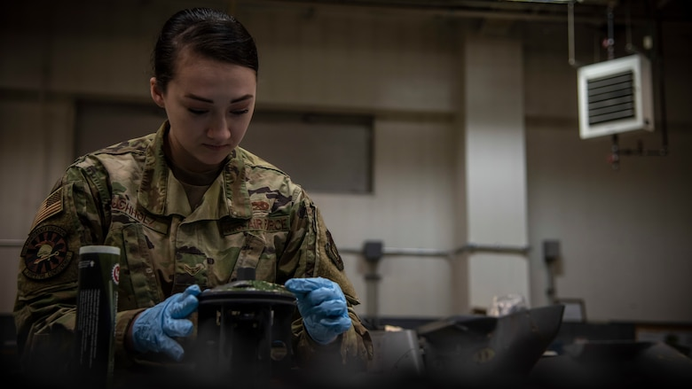 Airman 1st Class Lauren Buchholz, a 35th Maintenance Squadron armament maintenance member, applies lubricant to an M61A1 Vulcan gun system barrel at Misawa Air Base, Japan, Jan. 22, 2020. The almasol syntemp lubricant is used to prevent corrosion and overheating of the barrel. (U.S. Air Force photo by Airman 1st Class China M. Shock)