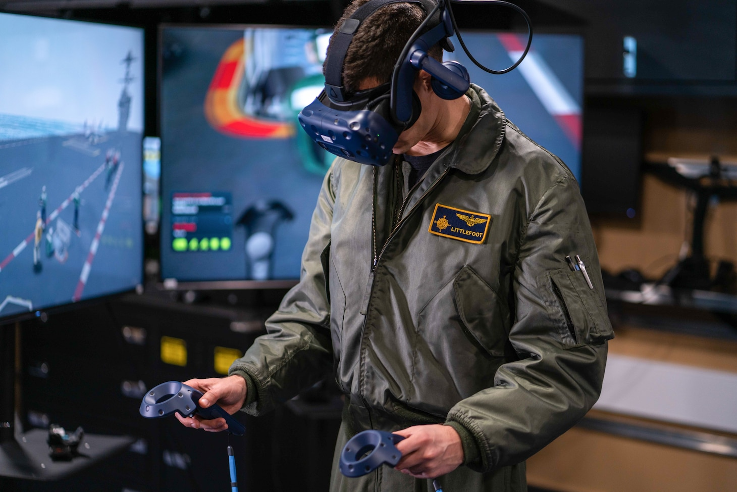 A Sailor operates a virtual reality computer though the use of a headset