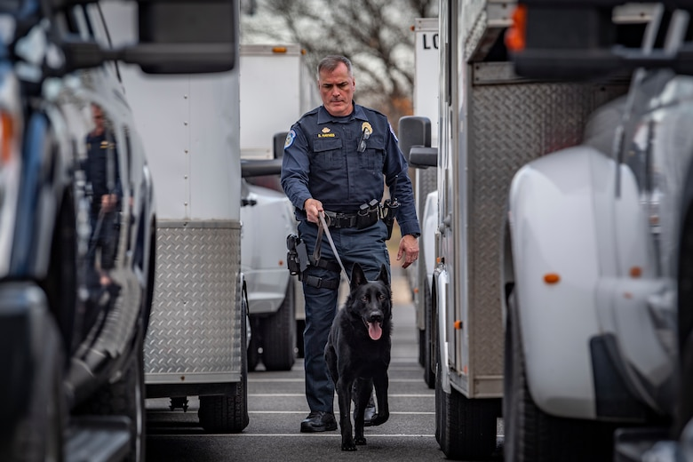 A United States Capitol Police (USCP) Officer and K-9 perform a sweep of West Virginia National Guard's 35th Civil Support Team (CST) vehicles prior to departing for the 2020 State of the Union Address on Feb. 4, 2020 in Washington, D.C. The 35th CST was strategically prepositioned to provide support to and in conjunction with the D.C. Fire and Emergency Management Services, the USCP, the D.C. National Guard and many other civil and federal agencies for the SOTUA. (U.S. Air National Guard Photo by Staff Sgt. Caleb Vance)