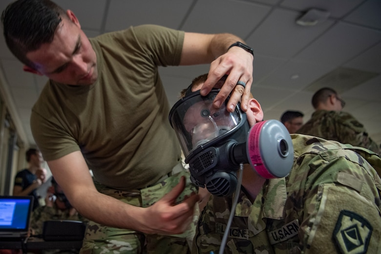 Sgt. David Dean (left) performs a mask fit test on Spc. Ian Lavigne (right), both assigned to West Virginia National Guard's 35th Civil Support Team (CST) on Feb. 3, 2020 at Joint Base Anacostia Bolling, in preparation for the 2020 State of the Union Address. The 35th CST is a joint-force unit comprised of the 130th Airlift Wing's CERF-P Detachment and Soldiers from the West Virginia Army National Guard, who's mission is to preposition at high-profile events in preparation to support civil authorities at domestic Chemical, Biological, Radiological, Nuclear or Explosive (CBRNE) incident sites. (U.S. Air National Guard Photo by Staff Sgt. Caleb Vance)