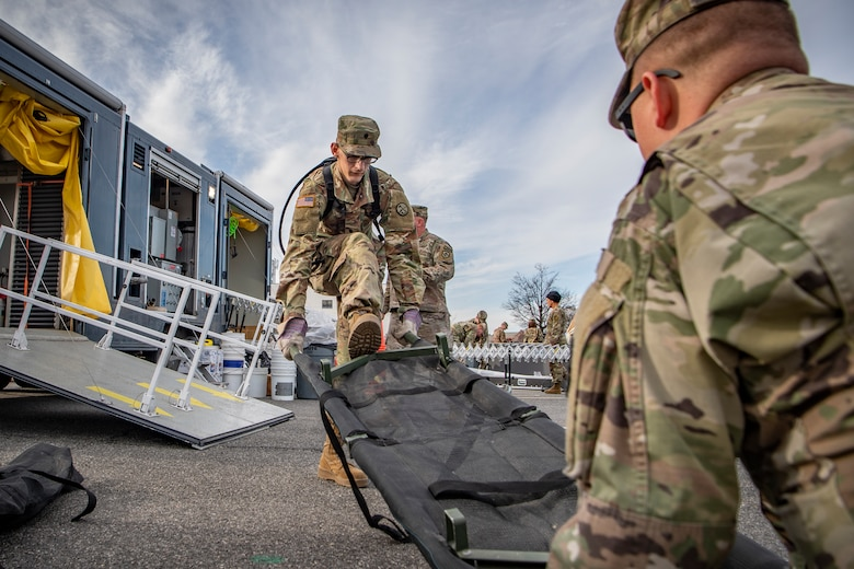 Spc. Alexander Dyer, a member of the West Virginia National Guard's 35th Civil Support Team,, prepares a gurney while participating in a response rehearsal on Feb. 3, 2020 at Joint Base Anacostia Bolling, in preparation for the 2020 State of the Union Address. The 35th CST is a joint-force unit comprised of the 130th Airlift Wing's CERF-P Detachment and Soldiers from the West Virginia Army National Guard, who's mission is to preposition at high-profile events in preparation to support civil authorities at domestic Chemical, Biological, Radiological, Nuclear or Explosive (CBRNE) incident sites. (U.S. Air National Guard Photo by Staff Sgt. Caleb Vance)