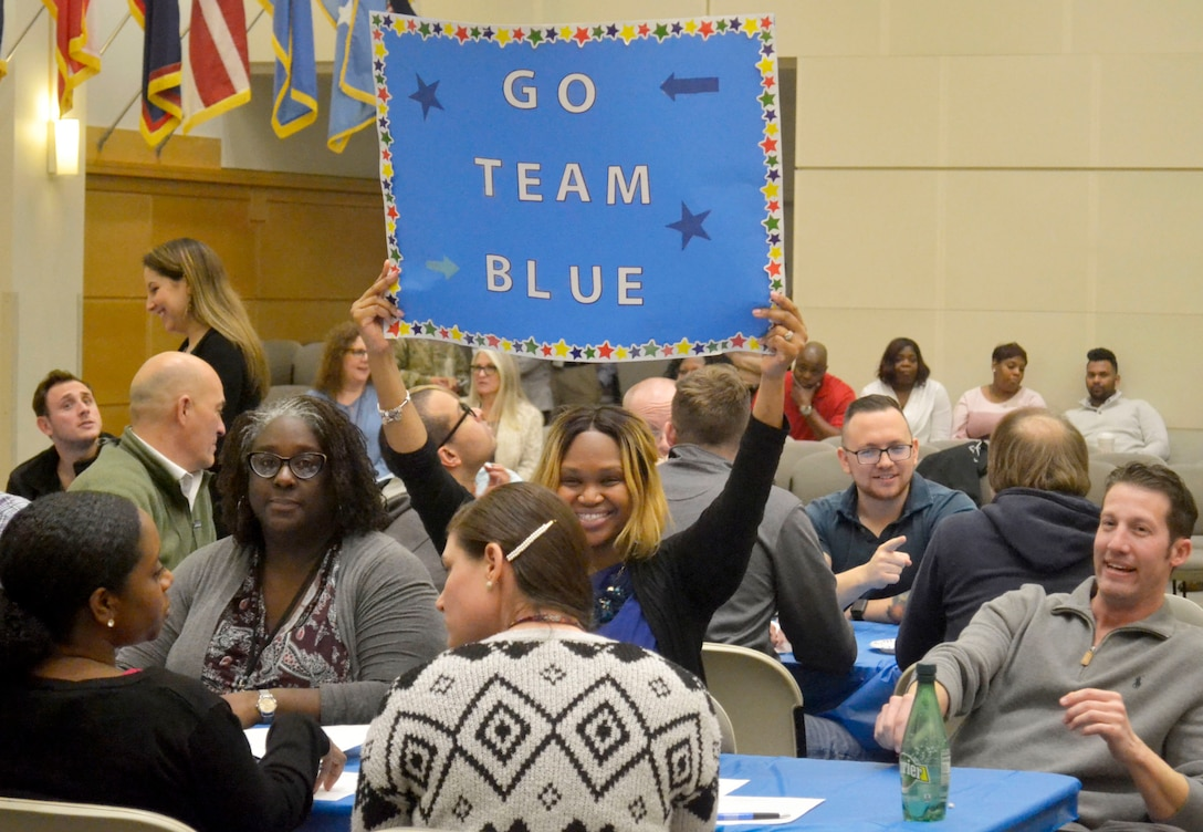 An Industrial Hardware employee holds a sign to applaud the IH supply chain during a trivia-based event Feb. 5, 2020, at DLA Troop Support in Philadelphia.