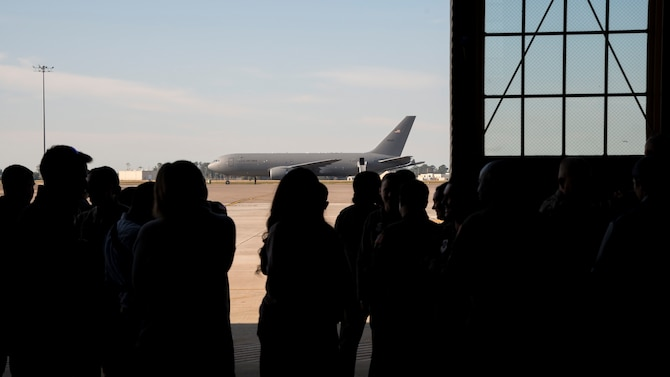 Tour guests wait to enter the flightline at MacDill Air Force Base, Fla., Jan. 29, 2020.