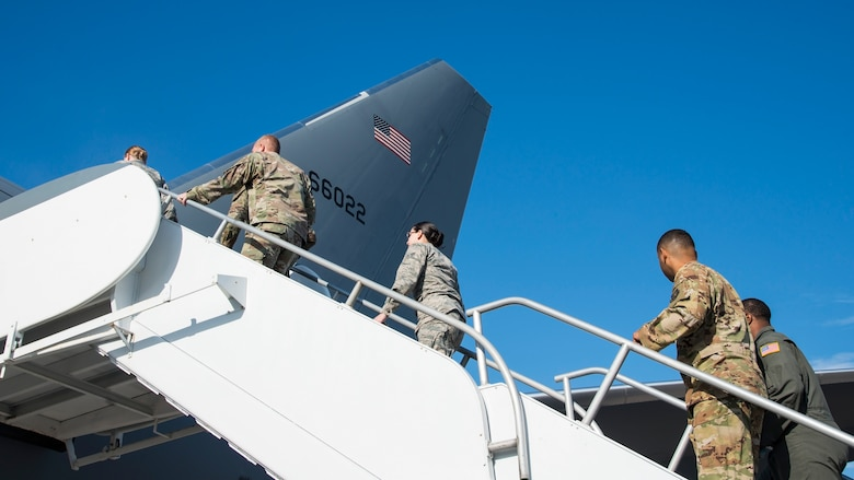 U.S. Air Force Airmen ascend a ramp to a KC-46 Pegasus aircraft assigned to McConnell Air Force Base, Kan., at MacDill Air Force Base, Fla., Jan. 29, 2020.
