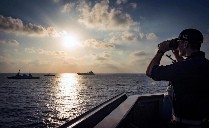 Ensign observes Israeli INS Lahav, left, INS Sufa, center, and USNS Leroy Grumman from USS Carney during exercise Reliant Mermaid 2018, Mediterranean Sea, August 7, 2018 (U.S. Navy/Ryan U. Kledzik)