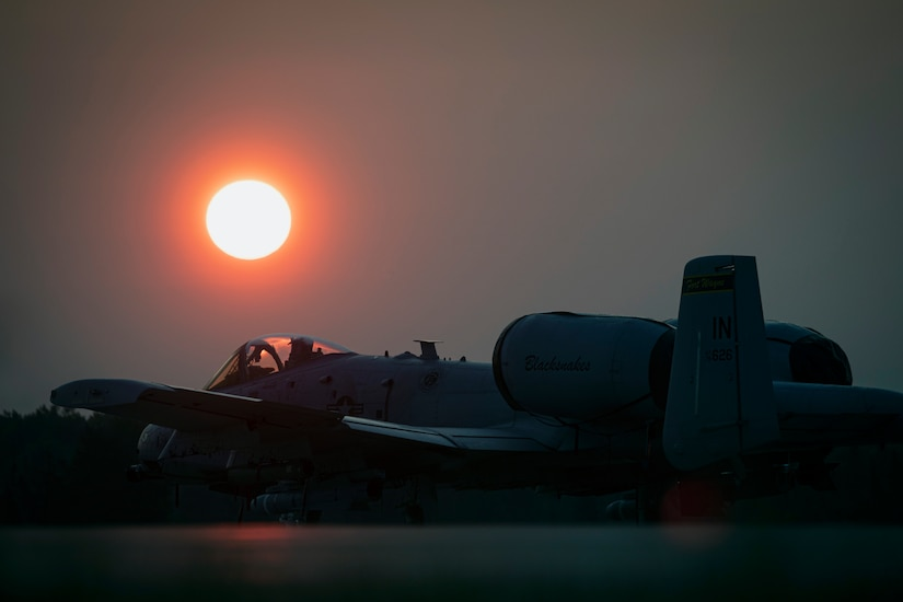Air Force A-10C Thunderbolt II from Indiana Air National Guard's 122nd Fighter Wing sits on flightline at sunrise during Northern Strike 19 at Alpena Combat Readiness Training Center, Michigan, July 26, 2019 (U.S. Air National Guard/Matt Hecht)