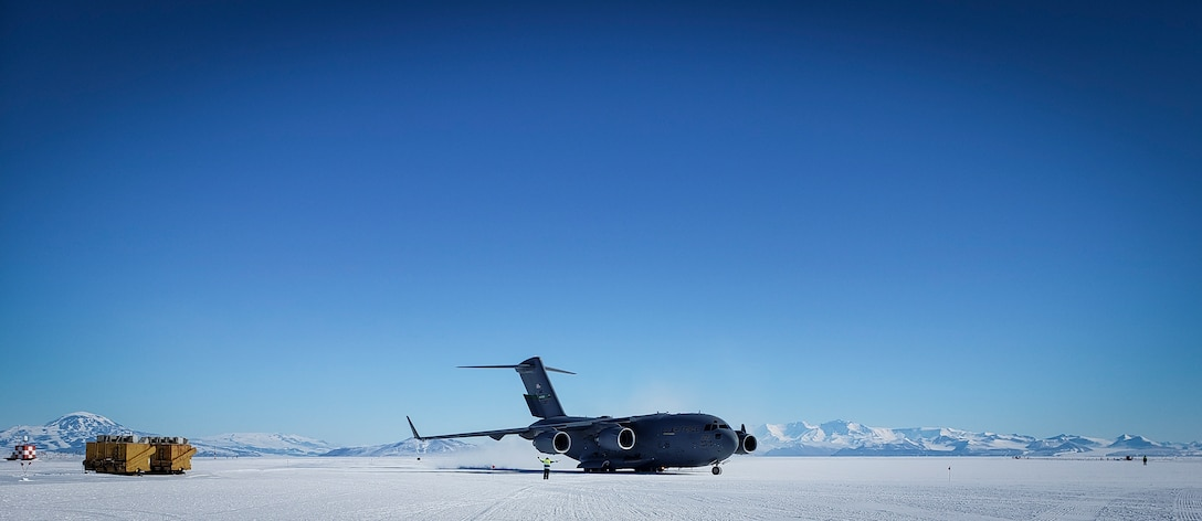 U.S. Air Force Master Sgt. Justin Rogers, an occupational safety specialist, 108th Wing, New Jersey Air National Guard, watches as a C-17 Globemaster arrives at McMurdo Station, Antarctica, Nov. 15, 2019.  Antarctica does not have a military mission, but the National Science Foundation receives airlift support from the 109th Airlift Wing, New York Air National Guard.Rogers backfilled as the 109th Safety Manager while at McMurdo Station. (Courtesy Photo)