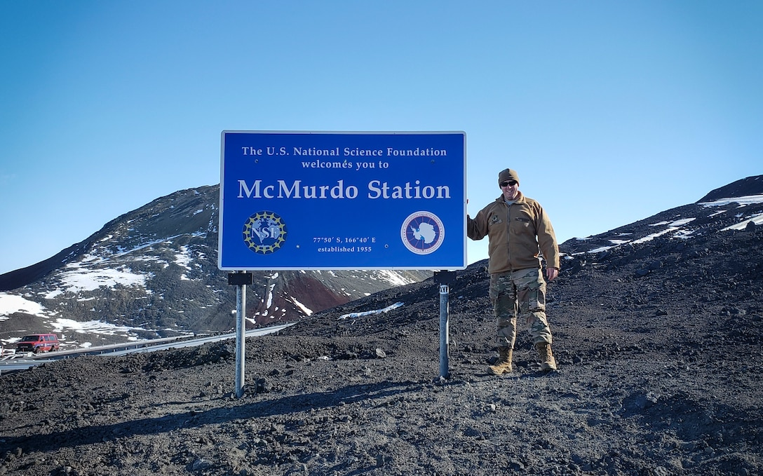 U.S. Air Force Master Sgt. Justin Rogers, an occupational safety specialist, 108th Wing, New Jersey Air National Guard, stands near the marker of McMurdo Station, AN, Nov. 8, 2019 .  Antarctica does not have a military mission, but the National Science Foundation receives airlift support from the 109th Airlift Wing, New York Air National Guard. Rogers backfilled as the 109th safety manager while at McMurdo Station. (Courtesy Photo)