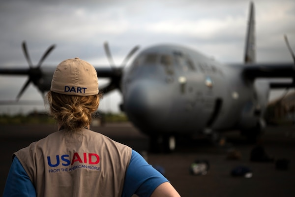 U.S. Agency for International Development worker waits for flight on C-130J Hercules assigned to 75th Expeditionary Airlift Squadron, Combined Joint