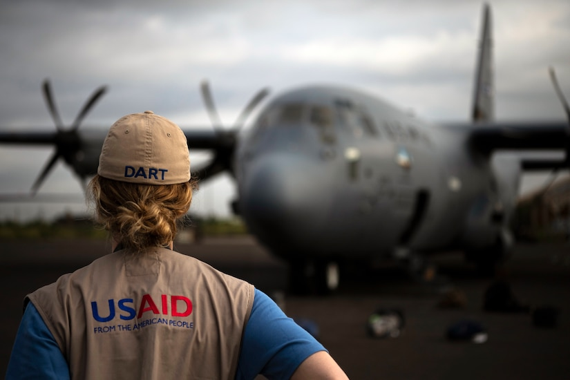 U.S. Agency for International Development worker waits for flight on C-130J Hercules assigned to 75th Expeditionary Airlift Squadron, Combined Joint Task Force–Horn of Africa, in Maputo, Mozambique, March 29, 2019 (U.S. Air Force/Chris Hibben)