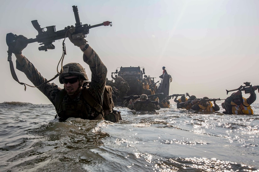 Marines currently under 4th Marine Regiment, 3rd Marine Division, and members of Indian military wade to shore during exercise Tiger Triumph, on Kakinada Beach, India, November 19, 2019 (U.S. Marine Corps/Christian Ayers)
