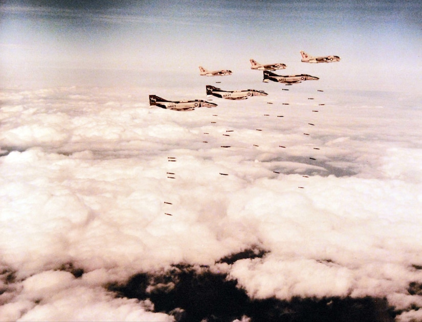 Three fighter squadron 161 Phantom II fighter aircraft from USS Midway and three Corsair II attack aircraft from USS America drop Loran bombs during strike mission in Vietnam, March 1973 (U.S. Navy/National Archives and Records Administration/Fred P. Leonard)