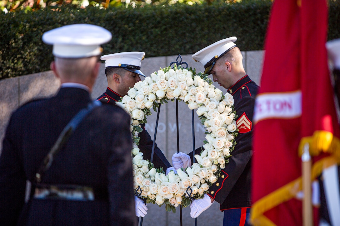 U.S. Marines lay a white rose wreath on a gravesite during a wreath laying ceremony for the 109th anniversary of President Ronald Reagan's birthday at the Ronald Reagan Presidential Library in Simi Valley, California, Feb. 6.
