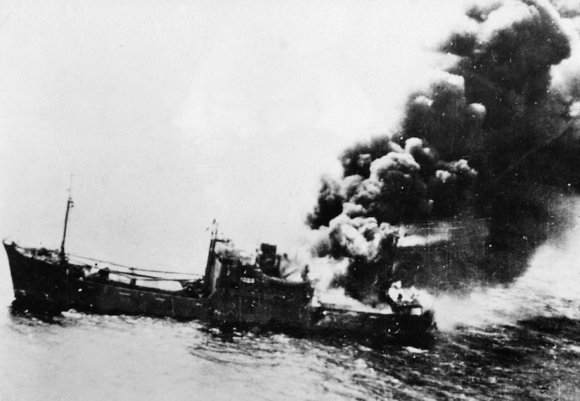 Struck by bomb in Battle of Bismarck Sea, Japanese merchantman burns fiercely, March 2, 1943 (U.S. Army/National Archives and Records Administration)