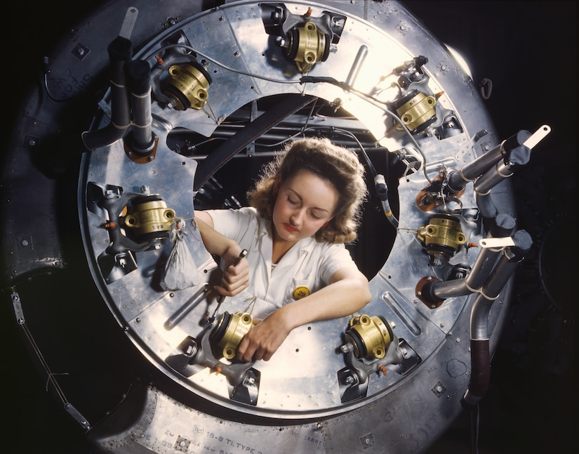 Part of cowling for B-25 bomber motor is assembled in engine department of North American Aviation's plant in Inglewood, California, October 1942