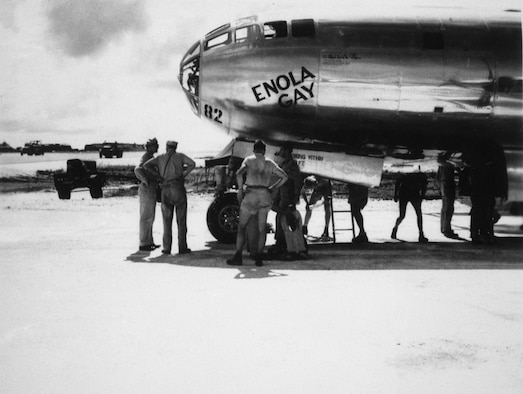 "Crews stand near the nose of the B-29 Superfortress nicked named ""Enola Gay."""