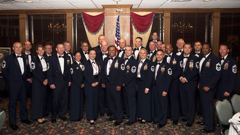 U.S. Air Force chief master sergeant selects and current Chiefs pose for a photo during a Chief's Induction Ceremony, Jan. 31, in Tampa, Fla. Only 1% of enlisted Airmen reach the rank of chief master sergeant.