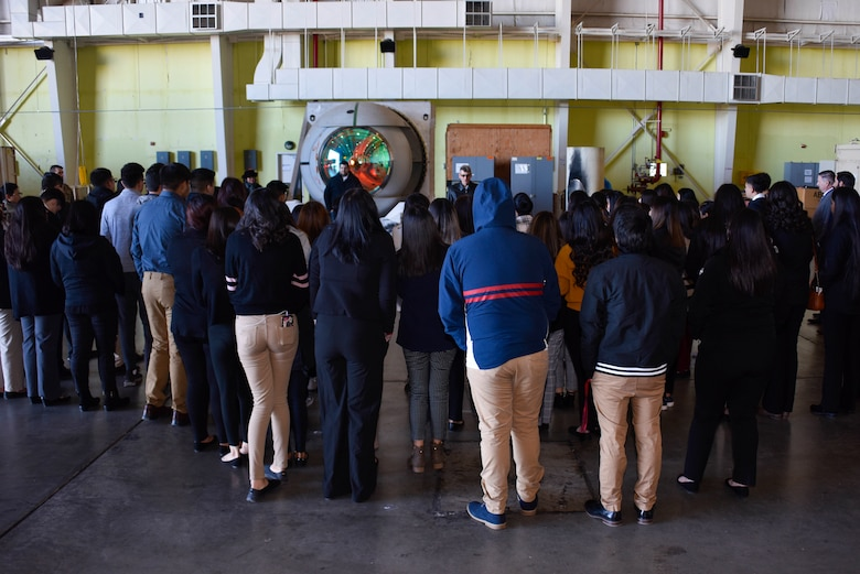 Photo of a group of students looking at an Airborne Laser Turret.