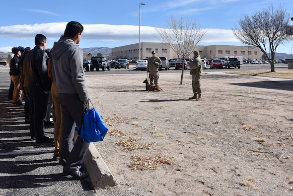 Photo of students watching a military working dog demonstration.