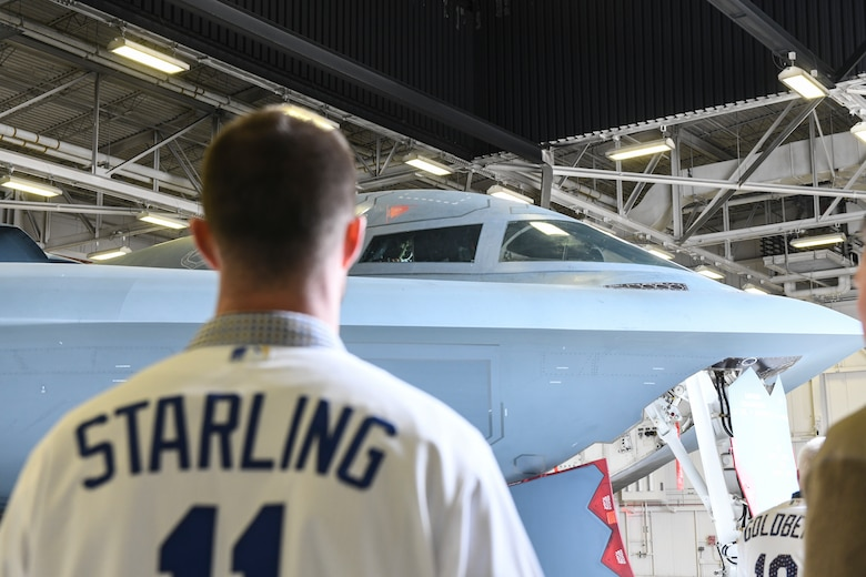 "Derek ""Bubba"" Starling, a Kansas City Royals outfielder, tours a B-2 Spirit Stealth Bomber, during a visit at Whiteman Air Force Base, Mo., Jan. 30, 2020. During the visit, KC Royals team members ate lunch with Airmen, toured a B-2 Spirit and participated in a meet and greet while learning about the Airmen and the jobs they perform. (U.S. Air Force photo by Staff Sgt. Sadie Colbert)"