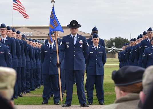 The newest U.S. Air Force Basic Military Training class stands at parade rest during the parade ceremony at Joint Base San Antonio-Lackland, TX, Jan. 31, 2020. The 305th Air Mobility Wing senior leaders visited BMT to acquire an understanding on what Airmen learn before they go to their first base.