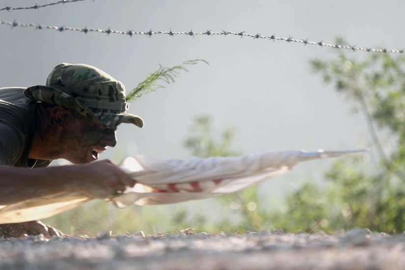 Paratrooper assigned to 37th Brigade Engineer Battalion, 82nd Airborne Division, navigates wire obstacle during Blood on the Water competition at Fort Bragg, North Carolina, September 7, 2018 (U.S. Army/Ryan Mercado)