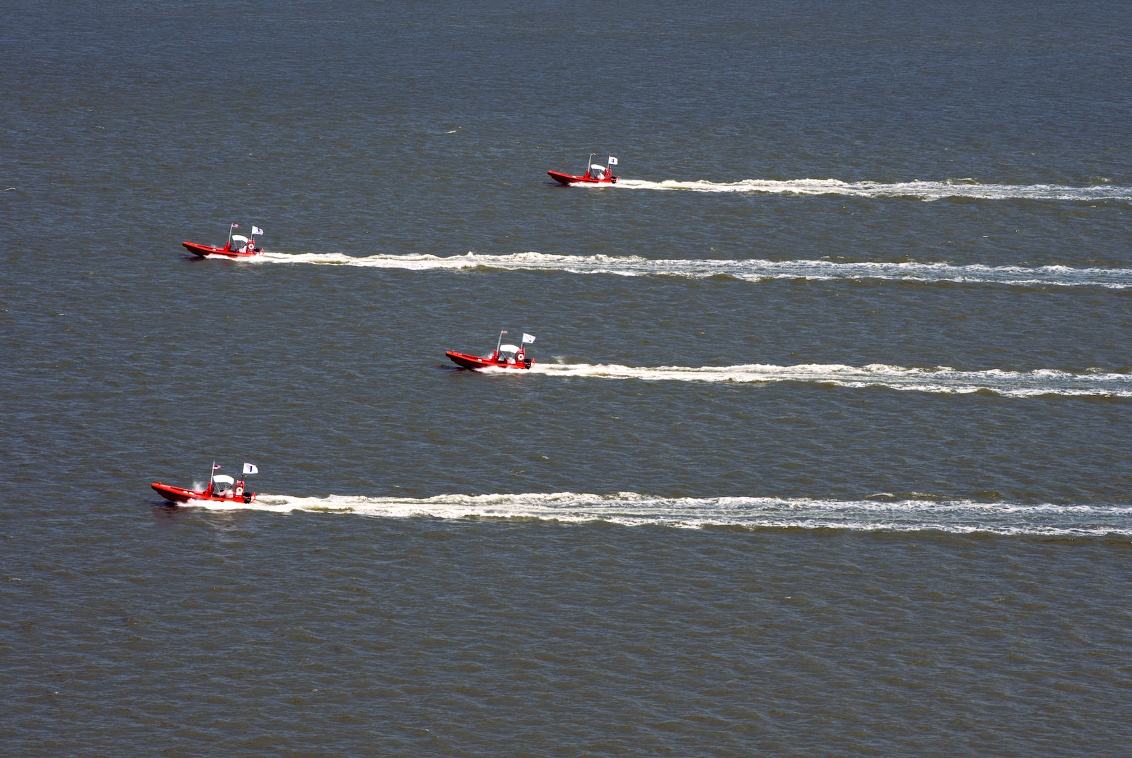 Four unmanned remotely operated high-speed maneuvering surface targets move to blocking positions on James River during Office of Naval Research– sponsored demonstration of autonomous swarmboat technology, Newport News, Virginia, August 13, 2014 (U.S. Navy/John Paul Kotara)