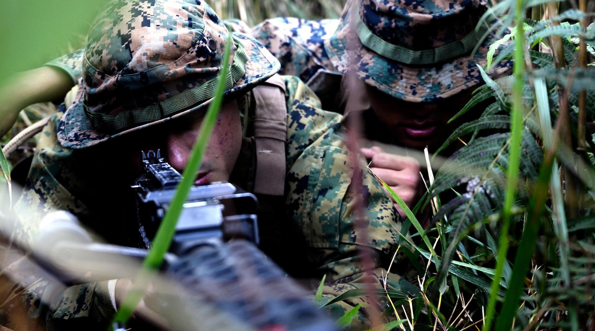 Marines with Headquarters Battalion, 3rd Marine Division, provide security for convoy during Samurai 2-20 on Camp Hansen, Okinawa, Japan, December 10, 2019 (U.S. Marine Corps/Kallahan Morris)
