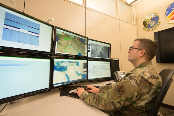 Tech. Sgt. Matthew O'Neill working at a computer.