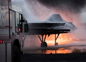 Fire truck hoses down a fire during a live-fire training exercise
