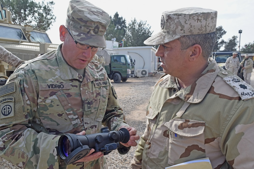 A U.S. Army Soldier (left), with Military Engagement Team-Jordan, 158th Maneuver Enhancement Brigade, Arizona Army National Guard, discusses functionally of a night vision device with a Jordan Armed Forces-Arab Army (JAF) Soldier during a Mine Resistant Ambush Protected Wheeled Armor Vehicle Subject Matter Expert Exchange at a base outside of Amman, Jordan in January. The U.S. military has a long-standing relationship with Jordan to support our mutual objectives by providing military assistance to the JAF consistent with our national interests. (U.S. Army photo by Sgt. 1st Class Elvis Sierra)