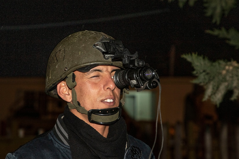 A Jordan Armed Forces-Arab Army (JAF) Soldier looks through a monocular night vision goggle during a Mine Resistant Ambush Protected Wheeled Armor Vehicle Subject Matter Expert Exchange with Military Engagement Team-Jordan, 158th Maneuver Enhancement Brigade, Arizona Army National Guard, at a base outside of Amman, Jordan in January. The U.S. military has a long-standing relationship with Jordan to support our mutual objectives by providing military assistance to the JAF consistent with our national interests. (U.S. Army photo by Sgt. 1st Class Shaiyla B. Hakeem)
