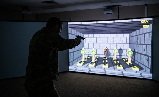 U.S. Air Force Staff Sgt. Thomas Badders, 325th Security Forces Squadron noncommissioned officer in charge of confinement, shoots at virtual targets at Tyndall Air Force Base, Florida, Feb. 5, 2020. Security Forces uses the Multiple Interactive Learning/Training Objectives Range to hone thier skills without the need to fire live rounds. (U.S. Air Force photo by Senior Airman Stefan Alvarez)