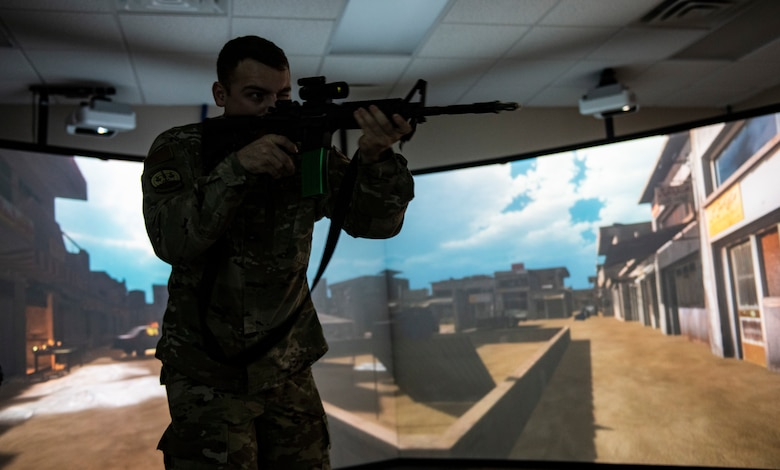 U.S. Air Force Staff Sgt. Thomas Badders, 325th Security Forces Squadron noncommissioned officer in charge of confinement, shoots at virtual targets at Tyndall Air Force Base, Florida, Feb. 5, 2020. Security Forces uses the Multiple Interactive Learning/Training Objectives Range to hone their skills without the need to fire live rounds. (U.S. Air Force photo by Senior Airman Stefan Alvarez)
