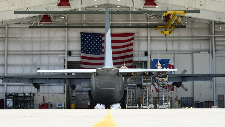 Maintainers work on aircraft