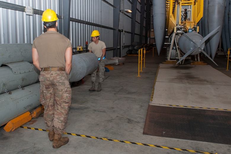 Photo of Airmen carrying a fuel cell