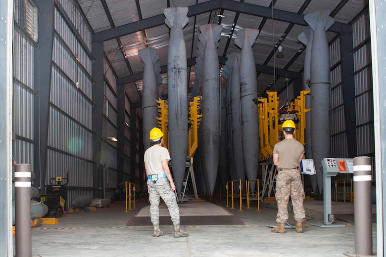 Photo of Airmen preparing to inspect a fuel cell